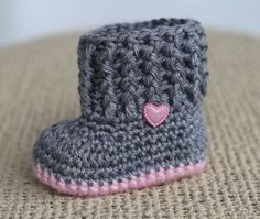 Sweet, sweet crochet baby booties made in Grey and Pink with a beautiful matching pink heart button. Baby Shower Gift, Valentine Gift, Easter
