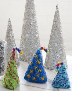 Instantly add a creative touch to your mantle, shelf, or side table with the Whimsical Tabletop Trees. These cute and colorful DIY holiday decorations are the perfect way to get rid of excess scrap yarn while readying your home for Christmas.