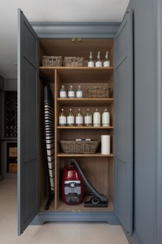 KINN Living | Organic, non-toxic, plant-based laundry products stored away in this luxury bespoke utility room cupboard at the Humphrey Munson showroom in Felsted #humphreymunsonblog