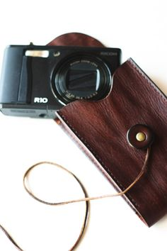 "leather camera case. ""Pleasure to take the photo will be increased""."