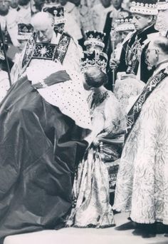 Prince Philip kisses Queen Elizabeth on the cheek after she has been anointed and crowned.