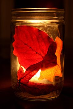 Easy peasy! Two glass jars nest with a votive candle inside the inner one. Between them: autumn leaves! So pretty.