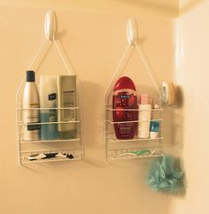 Shower caddies have a way of slipping off your showerhead's neck (and onto your head-- ouch!). For a more secure hold, use adhesive hooks that are designed to stand up to a steamy bathroom and place them on the opposite wall.