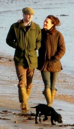January 12th, 2012: Catherine the Duchess of Cambridge and husband Prince William take an evening walk on Newborough Beach. The Duchess who turned 30 years old on Monday walked arm in arm with William and family puppy Lupo.