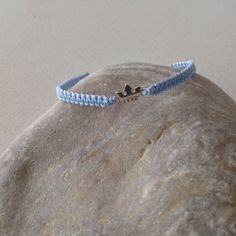 Items similar to Delicate sterling silver Crown pendant macrame/friendship baby Blue cord bracelet on Etsy Delicate, Crown, Sterling Silver, Trending Outfits, Pendant, Unique Jewelry, Bracelets, Handmade Gifts, Vintage