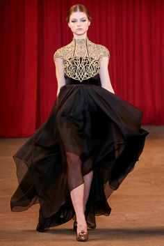 Christian Siriano 2013. Love the sculpted bodice with the gold and black