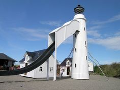 Nordsøen Oceanarium  The Lighthouse at Hirtshals, Denmark.  The playground refers to the Hirtshals Lighthouse, which is a Hirtshals landmark.  The playground consists of two houses, the lighthouse with an 11 m long slide and a large climbing net. It is possible to climb everywhere – even on the housetops.