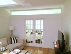 nyc apartment partition wall with transom window Temporary Wall Divider, Temporary Door, French Pocket Doors, Door Dividers, Slider Window, Loft Wall, Room Divider Walls, Door Makeover, Room Doors