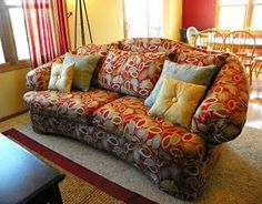 My very own ugly couch makeover - I reupholstered my old couch in a new fabric. Love it!