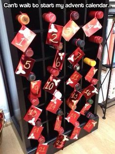 Advent Calendar....Hell yeah!  Is there a chocolate bar next to each wine bottle?  It would be perfect then!