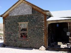 Rhyolite, Nevada: There is even a house here built of beer and whiskey bottles because lumber was in such short supply. Rhyolite is haunted by the spirit of the brown man, said to be a gold prospector who died in the town after he brought huge gold nuggets in to town to be tested. The legend says he was poisoned by the barber to get the gold. He is seen as a brown shadow with a big floppy hat wandering around town.