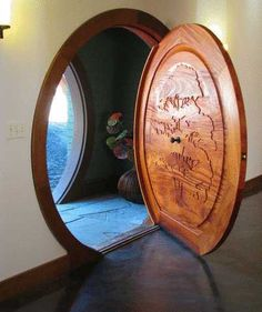 What modern Hobbit House would be complete without a real, hand-carved, circular Hobbit Door? Love it!