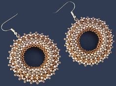 Description: gold and silver seed beads artfully woven into delicious glamorous discs.  Beautiful handmade artistry. (description by admin:)  Those earrings