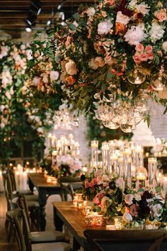 This venue was transformed into an indoor garden with lush florals tons of candles Image by Greer Gattuso Photography Table Decoration Wedding, Decoration Evenementielle, Reception Decorations, Wedding Centerpieces, Wedding Table, Indoor Garden Wedding Reception, Wedding Lighting Indoor, Indoor Wedding Decorations, Flower Centerpieces