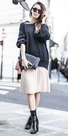 Pleated midi skirt + oversized sweater + patent leather boots + Julia Toivola + edgy spring style + quilted leather handbag + shades.  Brands not specified.