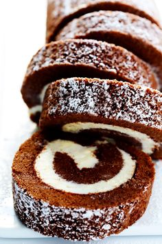 """This traditional Chocolate Roll recipe (a.k.a. """"Chocolate Swiss Roll"""") is easy to customize with your favorite filling — traditional cream cheese, chocolate, peppermint, or whatever other creative idea you might have. It's also easy to make ahead of time and freeze, and it is perfect for entertaining! And…the third roll's a charm. Guys! Since posting my favorite …"""