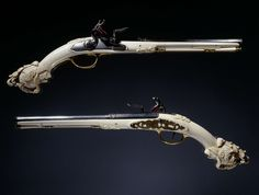"""""""A pair of carved ivory stocked flintlock Maastricht pistols crafted by Jean Louroux, On display at the Rijks Museum in Amsterdam """" Pistola Flintlock, Tactical Supply, Flintlock Pistol, Gun Art, Weapon Concept Art, Weapons Guns, Fantasy Weapons, Dieselpunk, Firearms"""