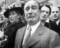 Man cries as Nazis march down the street in Paris.