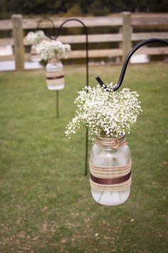 Baby's breath is simplistic and not expensive. It also goes with everything and is a traditional wedding flower. Think about baby's breath mixed with dried lavender? And maybe dried roses. Pepper Plantation Charleston, SC Fall wedding flowers - babies breath in mason jars as aisle accent