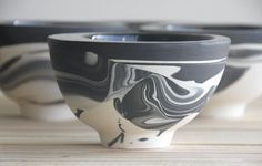 Hand made ceramic bowl in black and white. From the inside there is a glossy glaze. The bowl made in slip casting technique.