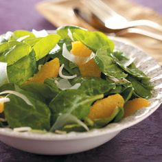 Orange Vinaigrette Spinach Salad Recipe -This special salad is lightly coated in a refreshing citrus dressing. I sometimes serve it with a side of cottage cheese…the taste of orange and all the cheeses will have your friends and family begging for more. —Jamie Pearson, Woodbury, Minnesota