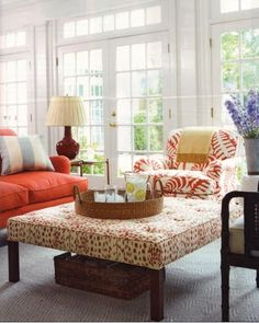 """Brunschwig and Fils """"Les Touches"""" on tufted ottoman in red."""