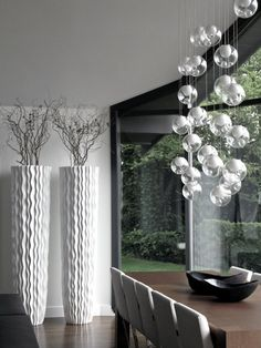 @Gaile Guevara's stunning interior design skills. i want this custom light piece by bocci. seriously!