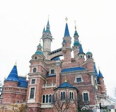 The new Enchanted Storybook Castle in Shanghai Disneyland. It will represent all Disney Princesses (instead of just one), and will be the largest Disney castle yet. It contains two attractions: Once Upon a Time Adventure, and Voyage to the Crystal Grotto