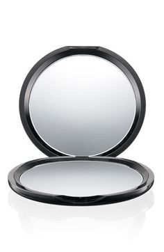 Plain black compac mirrors help soldier's shave when out in the field (and they don't have to use humvee mirrors). No magnification, and you want them to be able to stand upright on their own.