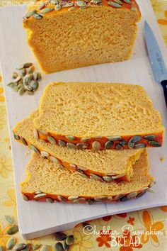 Cheddar Pumpkin Bread ~  A savory pumpkin loaf with cheddar cheese and crunchy pumpkin seeds decorating the top. it has the texture of a quick bread – soft, dense and fluffy with a subtle taste of pumpkin and sharp cheese. A match made in heaven!  Recipe @: http://www.cinnamonspiceandeverythingnice.com/cheddar-pumpkin-bread/
