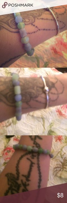 "Hand made bracelet Made by me :) glass beads and stretch cord used. Light green and light purple! Fits 6""-8"" wrists! Silver screw clasp closure. Andrea's Creations Jewelry Bracelets"