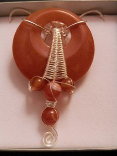 Large Orange Jade Doughnut with Carnelian Beads in Silver Wire - Handmade Wire-weaved Pendant with Gemstone - pinned by pin4etsy.com