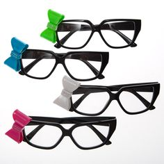 Black Nerd Glasses With Bow. One pair of glasses. Black frames are approximately 5 3/4 ″ x 1 3/4 ″. Decorative bow is approximately 1″ x 1 3/4 ″. Temples are approximately 5 1/2 ″ in length. Assorted colors.