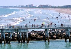 Crowds gather along the Jetty Park pier to wave bon voyage as the ships head out to sea. | Cruising from Orlando / Port Canaveral!
