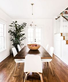 dining room featuring wood flooring and a hanging light.