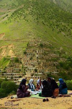 Kurdish Women enjoying each others' company in a village in the Hewraman region of Kurdistan, Iran. Photo by Parviz Rostami