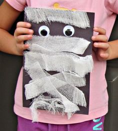This Halloween mummy craft is fun for the youngest of crafters. All you need is construction paper, gauze, and googly...