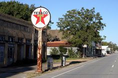 highway view of wallis texaco . what a great old sign Texas Signs, Vintage Gas Pumps, Vintage Stoves, Car Signs, Old Gas Stations, Porcelain Signs, Texaco, Environmental Graphics, Retro Cars