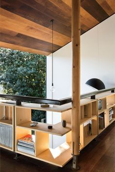 Modern small space in New Zealand with bookshelves in the mezzanine study