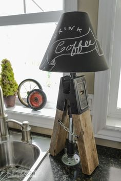 Junky sawhorse pipe lamps with chalkboard lampshades via FunkyJunkInteriors.net