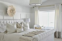 All white master bedroom with a hint of grey
