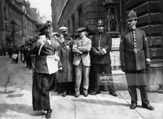 A suffragette sells the paper 'The Suffragette' outside Bow Street police station in London during the suffragette hearings.
