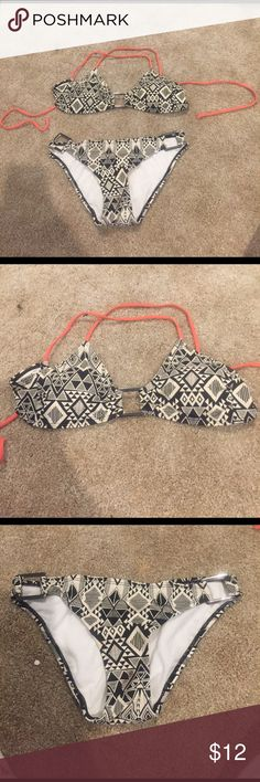 Pacsun super cute bikini Barely worn a summer. Originally bought at pacsun. It features a tribal pattern with bright coral ties. Little to no padding in the top! PacSun Swim Bikinis