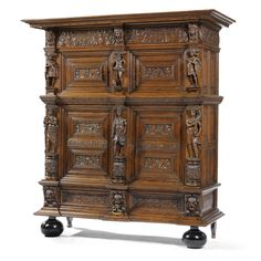 A Dutch carved oak cupboard or 'Beeldenkast' Renaissance, first half 17th century the protruding cornice above an acanthus scrolled frieze flanked and divided by male and female masks, above two panelled doors depicting allegorical figures of Faith and Charity, interposed by male figures, the lower two doors depicting allegorical figures of Hope, Fortitude, Justice and Prudence, flanked and divided by allegorical male and female terms,