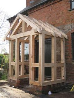 Traditional oak frame specialists in Sussex, garage frames, porches, roofing.oak garages sussex