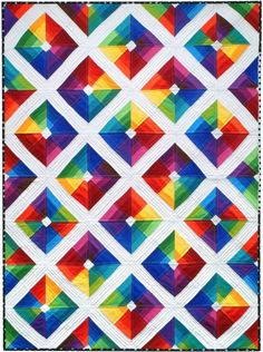 """Free """"Kite Flight"""" pattern from Robert Kaufman. I think the dense quilting on the white sashing really lets the colors pop even more than they otherwise would."""