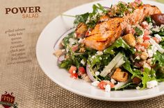 The Power Salad: grilled salmon (or chicken), baby kale, quinoa, tomato, cucumber, chick peas, red onion, feta cheese, summer citrus vinaigrette