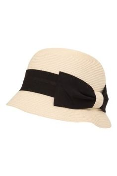 9bdfb2be319 Amazon.com  White Cloche Hat with Black Side Bow Band  Clothing - StyleSays