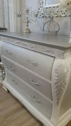 Elegantly refinished Bombay dresser. Finished in all my favorite colors. Gray, white, silver, lightly distressed and a little shimmer :) and the added French style knobs finished the look.