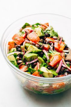 The easiest black bean tomato avocado salad with red onions and cilantro. This is a chunky salad that tastes like guacamole! Perfect with grilled chicken!